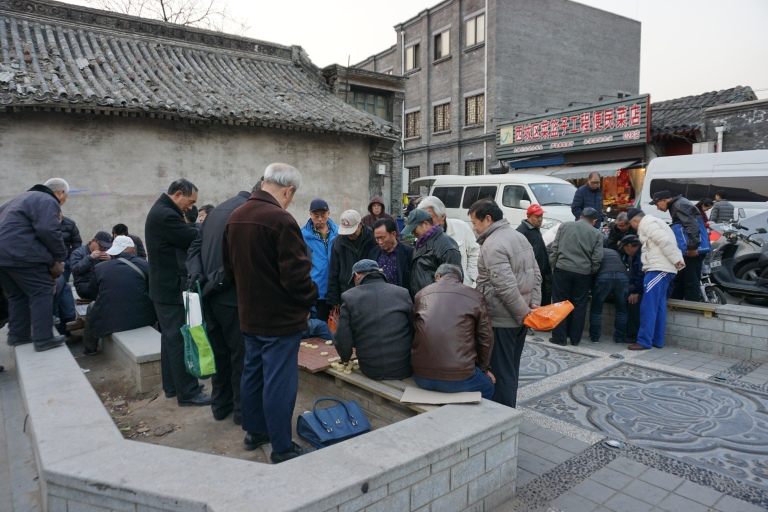 Men playing checkers in a hutong